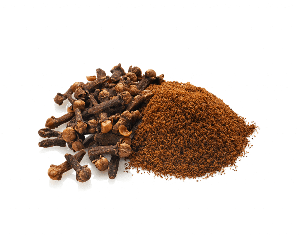 Cloves, both whole and ground, on a white background, relating to the terpene Caryophyllene found in CBD.