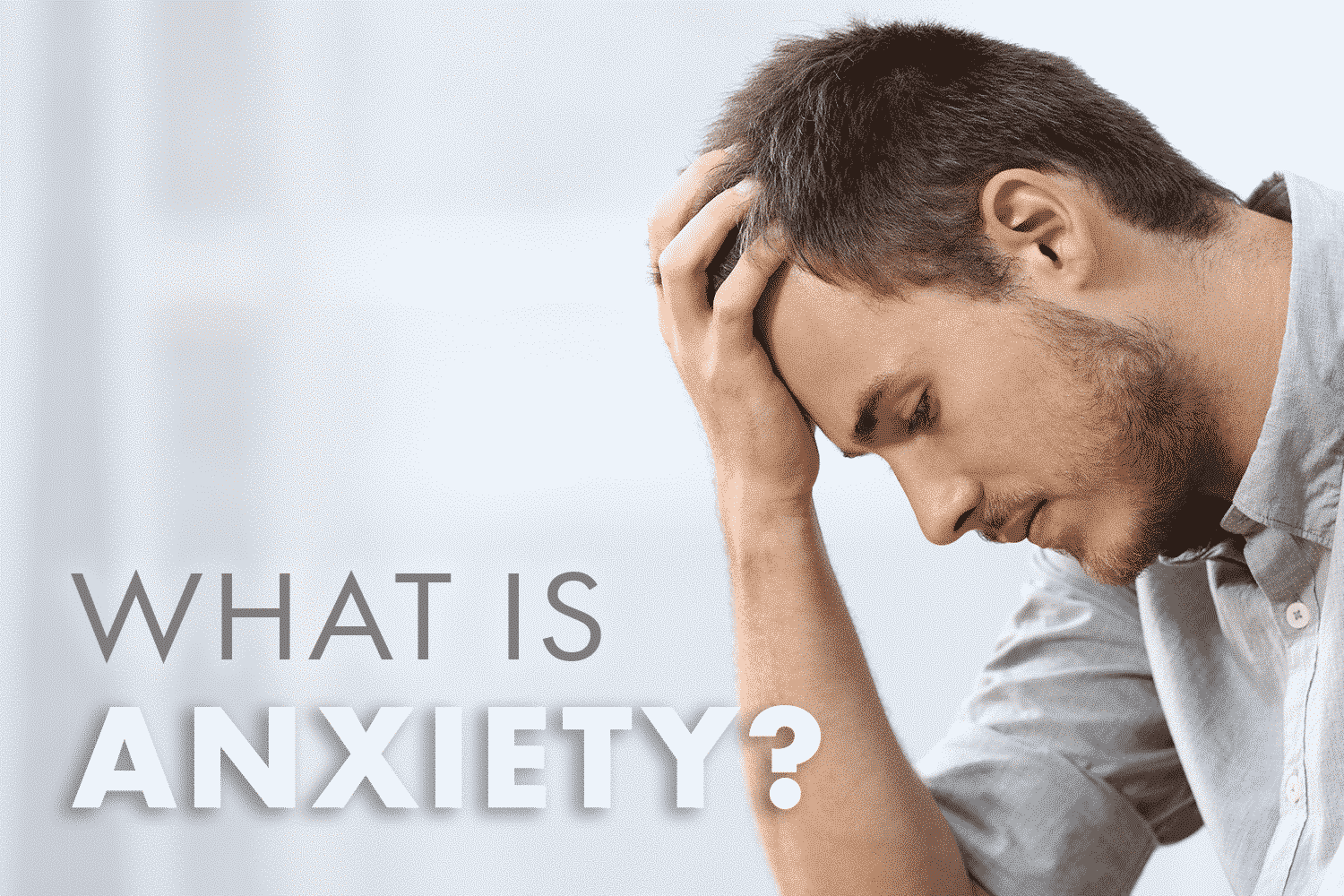 Dragonfly CBD What is Anxiety Blog cover Image, man holding head in hand looking anxious