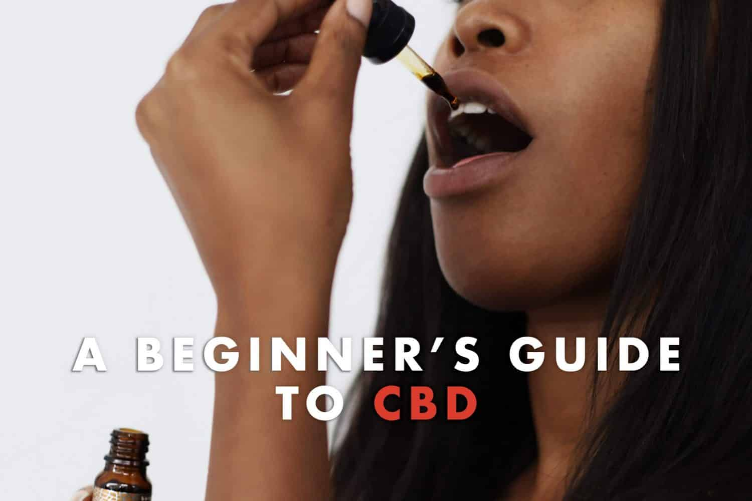 Woman taking CBD oil underneath her tongue